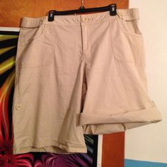 Lane Bryant khaki shorts Never worn! Can be longer or shorter with a quick roll up and button on side Venezia Shorts