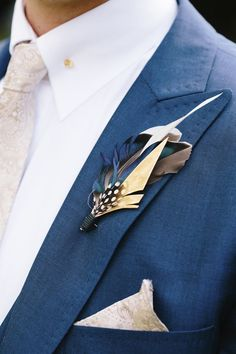 Unique Boutonnieres For Grooms And Groomsmen crazyforus is part of Boutonniere wedding Here are 27 unique boutonnieres for grooms and groomsmen; from Weddingomania A boutonniere is an indispensable - Feather Boutonniere, Groomsmen Boutonniere, Groom And Groomsmen, Wedding Boutonniere, Unique Groomsmen Attire, Wedding Pins, Wedding Day, Gay Wedding Flowers, Jazz Wedding