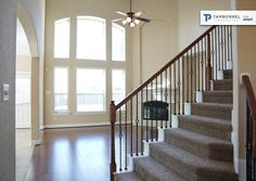 Tall windows allow natural light do a amazing job with lighting  #home #thewoodlands #creeksidepark #tamborrel #windows #lighting #natural #daylight #wood #floors #stairs