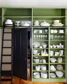 desire to inspire - desiretoinspire.net - Tim CuppettArchitects.  Another view of the open shelving.  Love that it's built in around the door and a library ladder to access it all.