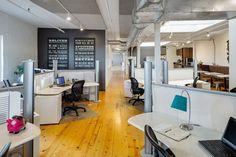 Open concept desk and pods at Norbella - Boston Headquarters