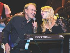 """Glen Campbell performs onstage with Ashley during his 2012 Goodbye Tour at Route 66 Casino's Legends Theater in Albuquerque, New Mexico.   VIE Magazine - March 2018   The Entertainers Issue   """"The Rhinestone Cowgirl Blazes Her Own Trail: Ashley Campbell on her """"rootsy"""" sound, playing by ear, and making her dad proud""""   Story by Tori Phelps   Photo by Steve Snowden/Getty Images"""
