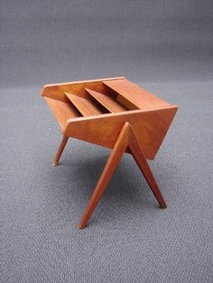 Mid-Century Magazine Rack imported from Denmark.Three compartments on a gorgeous set of V-shaped Legs. 49w x 37d x 38h. Circa 1960's.  	$375.00