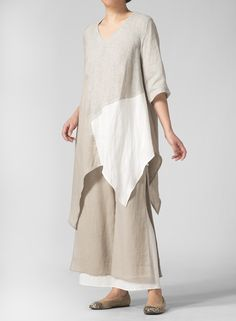 Linen Patten Handkerchief Hem Blouse   Proclaim your style with pride with this stunning, dramatic, uneven hem blouse. Relaxed fit gently drapes off the body for maximum comfort.