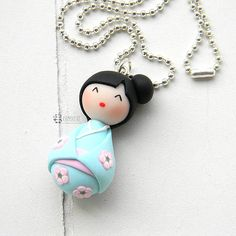 Kokeshi Doll in polymer clay (Fimo) Each pendant is handmade in polymer clay without the use of molds. The chain of the necklace is nickel free. Pendant size:  about 3,5 cm Chain lenght: 70cm Colour of the chain: silver ------------------------------------------------------- All polymer