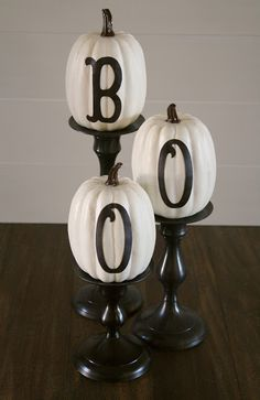 I love the sophisticated & simplistic beauty of these white pumpkins with the black letters displayed on candlesticks.