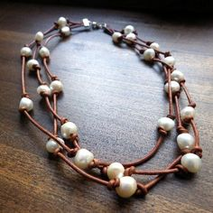 """$80 Ask any southern girl, and she'll tell you... pearls go with everything! Our Cowlicks and Kudzu Dixie triple strand freshwater pearl and leather necklace goes perfectly with anything from a cute dress to jeans and a t-shirt. Each pearl is hand knotted on the leather in our facility in Griffin, GA. 18"""" - See more at: http://www.morgan-company.com/product.cfm?p=3849&c=47&page=cowlicks-and-kudzu-dixie-pearl-and-leather-necklace#sthash.0DriKoYt.dpuf"""
