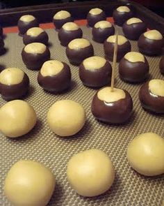 Wilde in the Kitchen: Ohio Buckeyes 9 oz cup) creamy peanut butter 8 tbsp stick) butter, at room temperature 1 tsp vanilla 3 cups powdered sugar 1 package Dark chocolate candy melts Candy Recipes, Holiday Recipes, Cookie Recipes, Dessert Recipes, Just Desserts, Delicious Desserts, Yummy Food, Holiday Baking, Christmas Baking