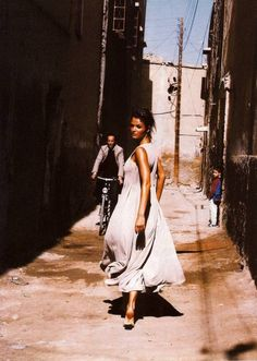 "Helena Christensen in ""Our Woman in Havana"", Vogue UK March 1994, photographed by Mikael Jansson, styled by Kate Phelan."