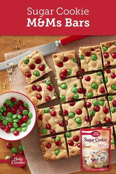 This bar is perfect to round out your cookie exchange - colorful holiday chocolate candies white vanilla baking chips and sugar cookie mix makes this a snap to make and bake Expert tip Drizzle melted white or dark chocolate on bars for some added flair Köstliche Desserts, Holiday Desserts, Holiday Baking, Holiday Recipes, Delicious Desserts, Dessert Recipes, Cake Recipes, Christmas Deserts, Christmas Party Food