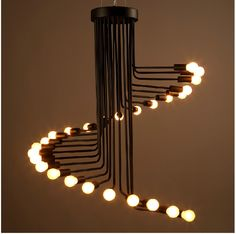 Люстра Lustre Loft может стать прекрастным арт объектом Вашей гостинной, гостиницы или ресторана К-во источников света — 26 Высота — 1500 мм Напряжение — 220 V Материал — метал Площадь освещения — 10-15 кв.м Лампы в комплект не входят