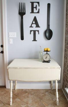 Adorable kitchen from A Diamond in the Stuff - I could do this look with my large spoon and fork in my dining area!