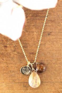 Rutilated quartz and garnet with a smal pretty lotus charm.