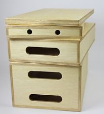 Stack apple boxes to make standing desk stool. Bottom has casters, rest have padding on edges to transform into stools