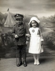 Children posing as WW1 soldier and nurse