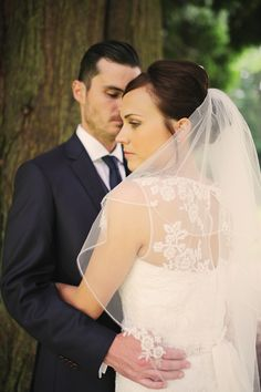 "Real Bride Emma wore our C249B veil in a 54"" length."