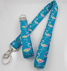 This is a listing for a very pretty pink and turquoise flamingo lanyard and key fob. They are handmade by me with 100% cotton fabric measuring 40-42 inches around and one inch wide. The key fob measures about 5 inches long. The key fob is also make with interfacing to give it body and shape. Both will include a split ring for an ID badge, keys, store scan cards, etc. I will mail this out within 2-5 days after payment is received. PLEASE make certain you are giving me the exact complete…
