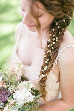 Flower Dotted Fishtail: http://www.stylemepretty.com/2015/04/12/20-bridal-fishtail-braids-we-love/
