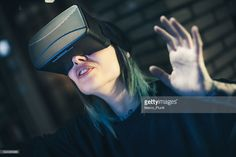 7b392077f39f Photo of a young woman looks fascinated into Virtual Reality Headset