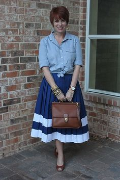 I continue to be dubious about knotting the front of shirts, and I'd probably only wear one bracelet (if any), but other than that I really like this outfit. #full_skirt #button_down_shirt #blue #white