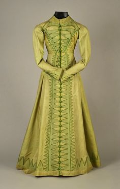 NILE GREEN FIGURED SILK PELISSE, with an appliqué of piped satin Van Dyke points along center front, hem and cuffs with pleated rolls of satin, neckline edged in black velvet, faux dorset. 1800s Fashion, 19th Century Fashion, Victorian Fashion, Vintage Fashion, Vintage Outfits, Vintage Dresses, Antique Clothing, Historical Clothing, Historical Dress