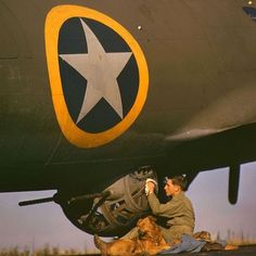 the_ww2_memoirs An ball-turret gunner belonging to the 8th Air Force cleans the ball-turret of the B-17 Flying Fortress with a rag and his dog by his side on an Air Force base in England, 1942. The ball turret was the most dangerous and painful position that could be assigned on a bomber. You were constantly cramped and unable to move for hours at a time. The battle turret was made out of Plexiglass and was equipped with two 50. Caliber machine guns. The unlucky crewman who occupied the…