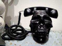 Skull phone seen on hipbones