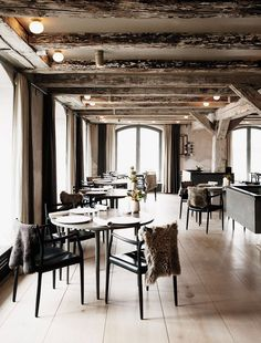 Noma's muted black and gray tones with fur cloak–draped chairs are a perfect foil for René Redzepi's cuisine.