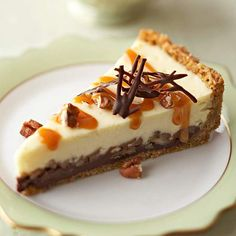 Black Bottom Cheesecake~ A layer of pecan-studded ganache cheesecake is topped with caramel sauce and bits of chocolate before serving.