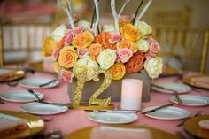 Coral wedding with beautiful glitter table numbers!   Table Numbers by ZCreateDesign www.ZCreateDesign.com