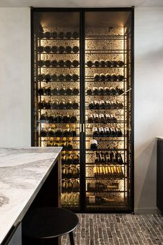 Wine storage with Ceppo di Gre wall by Potier Stone - Wille Offices in Knokke Belgium #luxuryoffice