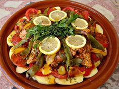 Marinated fish, potatoes, tomatoes and peppers are layered in this classic Moroccan tagine seasoned with ginger, saffron and lemon.