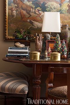 An antique library table has a hearty presence on one end of the great room. - Traditional Home ® / Photo: John Bessler / Design: Lisa Hilderbrand