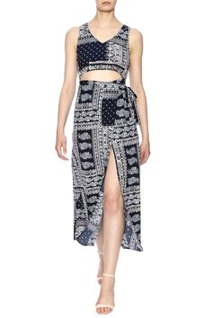 Blue printed maxi dress with a scoop neckline, midriff cut out, front wrap skirt and a hidden zipper back closure.  Print Maxi Dress by Illa Illa. Clothing - Dresses - Maxi Clothing - Dresses - Printed Clothing - Dresses - Casual Los Angeles, California