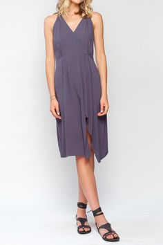 Cross front slit dress with open back feature. Super drape and flattering. Pair with flat sandal and a floppy hat! Hits right beneath knee. Slit in front is mid leg.   Sleeveless Lourdes Dress by Gentle Fawn. Clothing - Dresses - Casual Michigan