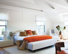 Room/Style: Bedroom, Beach  Notes: In the master bedroom of a Nantucket home, a pair of Carlo Colombo lamps flanks a custom-made bed upholstered in a Bergamo linen; the bench is by Christian Liaigre, the armchair is by Antonio Citterio, and the walnut chairs are by Flexform.     Photographer: Roger Davies   Designer: Rebecca Ascher   Featured in: A Contemporary Nantucket Retreat