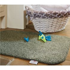 Hug Rug doormats and runners - Sage Green. Machine washable dirt trapper mats perfect for collecting mud and wet. Eco friendly and made in the UK. Free UK delivery.