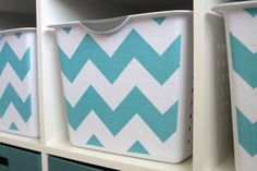 Cheap plastic tubs paint a design and then label - bathroom stuff  Looks like dollar general type storage bins with little holes al over. Covered with maybe shelf liner? Cute redo!