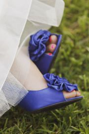 I like the idea of having blue shoes. It doubles as my something blue while also being a surprise!