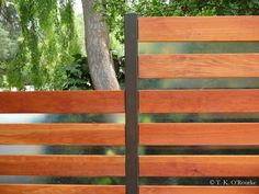If youre wary that gaps in the fence might lead to gaps in security consider mixing your materials. This steel fiberglass and wood fence by TKO Structures helps make this Hollywood home a fortress without making its occupants feel walled in. Brick Fence, Front Yard Fence, Wood Fences, Bamboo Fencing, Farm Fence, Cedar Fence, Cheap Privacy Fence, Privacy Screens, Modern Fence Design