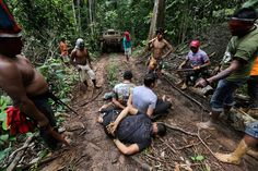 Ka'apor warriors stand guard over illegal loggers they tied up during a jungle expedition to search for and expel them from the Alto Turiacu Indian territory