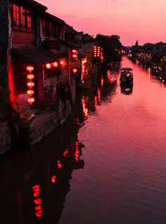 The color, the light, the reflection..the lanterns!..Beautiful capture of China.
