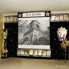 Turn up the drama at your Hollywood theme party by setting up a big TV or projector wall, with a fun film strip border and Hollywood banner for a silver-screen feel.