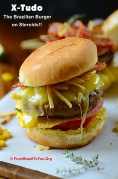 X-Tudo -- The Brazilian Burger on Steroids!!! An Outrageously delicious, tall burger with many toppings: Juicy beef patty, melted cheese, bacon, fried eggs, ham, corn, lettuce, tomato, and shoestring potatoes...