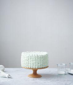 simple white frosting design. vertical star-tip swirls.