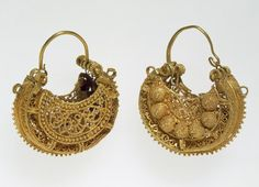 An elaborate example of filigree and granulation work from the Fatimid period in Egypt and Greater Syria (969–1171), this pair of earrings is illustrative both of the most characteristic goldsmith work and of one of the most popular shapes for jewelry of this period—thehilal, or crescent (moon).
