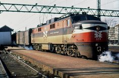 New Haven GE EP-5 (jet) locomotive # 379, is seen at an unknown station along the electrified mainline in Connecticut, early 1960's, Mac Seabree Collection