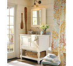 Coastal cottage bathroom - I really love this vanity, the paddles, light fixture, walls, etc!