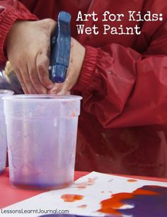 A fun wet paint activity for kids: thin acrylic paint in squirt bottles and cups.
