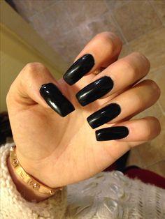 Long black acrylic square nails.